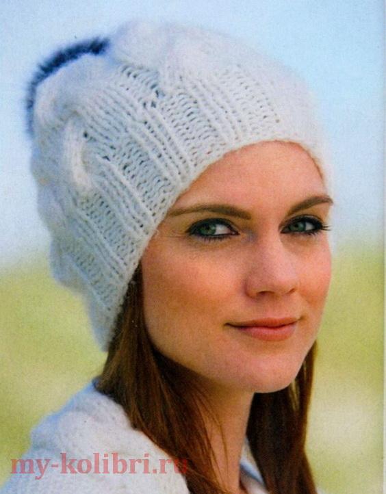Модная шапка спицами с косами и помпоном
