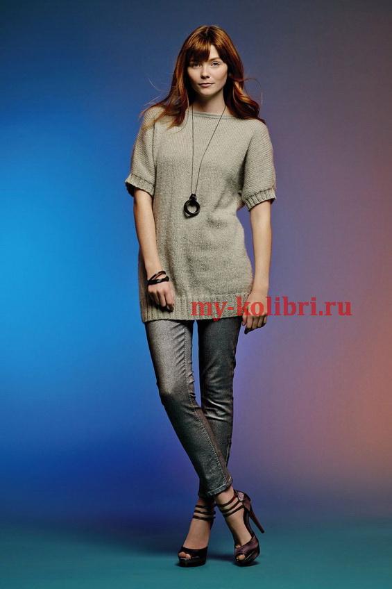 Длинный свитер спицами с застежками на спине